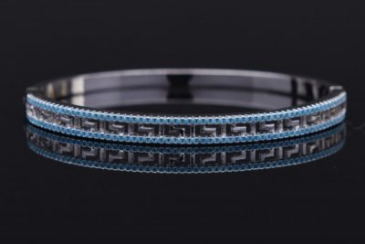 The copper magnetic 925 silver designs for women bracelet with two rings of blue gems